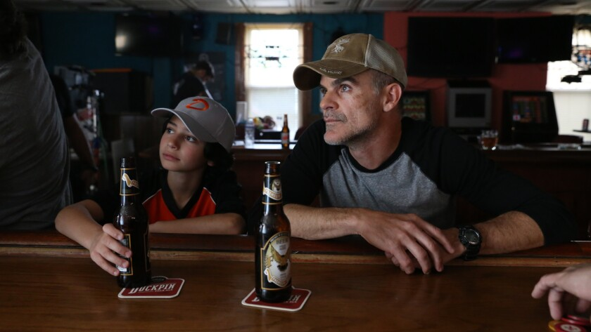 "(L-R) - Jesse Ray Sheps and Michael Kelly in a scene from ""All Square."" Credit: Vertical Entertainme"