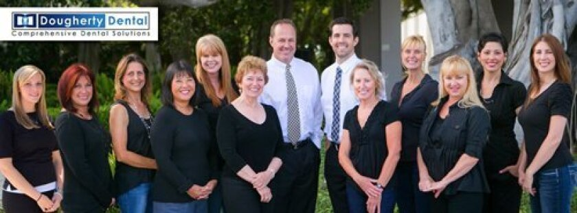 Dougherty Dental consists of Dr. Paul Dougherty and Dr. Weston Spencer (center) and their dedicated and educated dentistry team. Half of the staff has been there for more than 10 years. (Courtesy Photo)