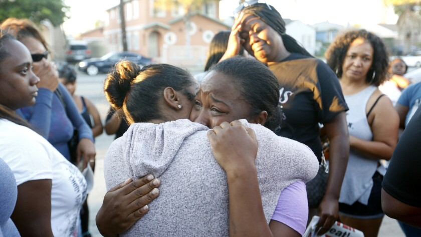 LOS ANGELES, CA - AUGUST 17, 2016: Prescious Sasser (CQ), mother of 18 year old Kenny Watkins cries