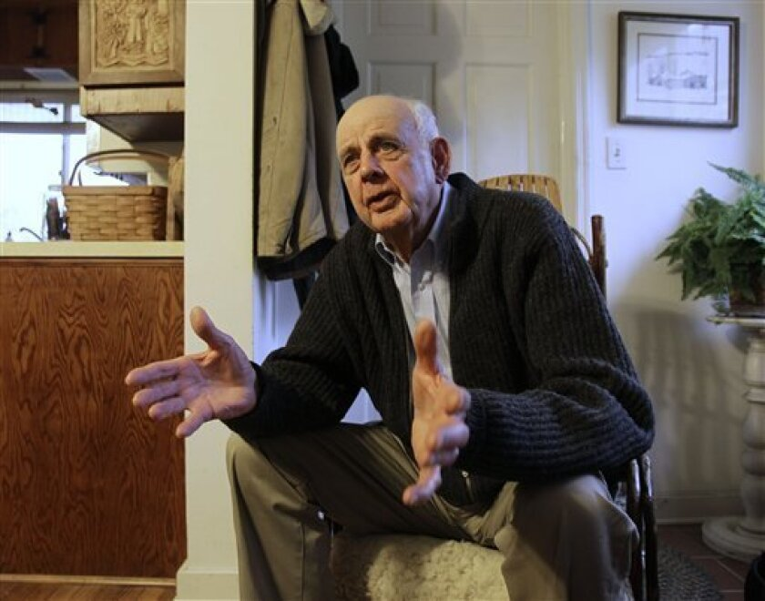 """In this March 10, 2011 photo, author Wendell Berry talks with a reporter at his home in Port Royal, Ky. From a three-day protest in the Kentucky governor's office to receiving a major honor at the White House, environmentalist and author Wendell Berry says he's had a lot going on lately. Last month he joined environmentalists for a sit-in at the office of Gov. Steve Beshear to protest strip-mining in Appalachia. Two weeks later, the 76-year-old author of 40 books was honored as a recipient of the National Humanities Medal for """"achievements as a poet, novelist, farmer, and conservationist."""" Authors John Updike, Toni Morrison and holocaust survivor Elie Wiesel have been awarded the medal in past years. (AP Photo/Ed Reinke)"""