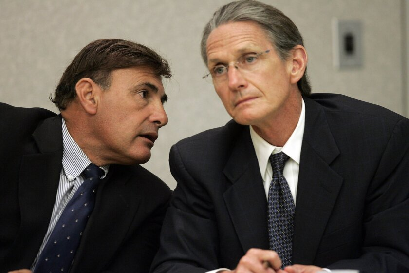 Former CHP Officer Abram Carabajal (left) talked to attorney William Mueller at yesterday's hearing. The judge declined to reduce the charges to misdemeanors. (John Gastaldo / Union-Tribune)
