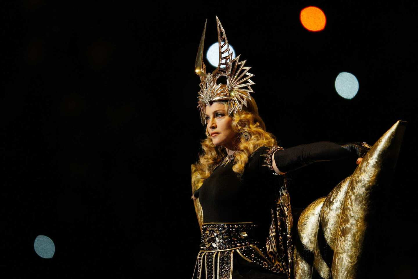Madonna performs during the Super Bowl XLVI halftime show in Indianapolis.