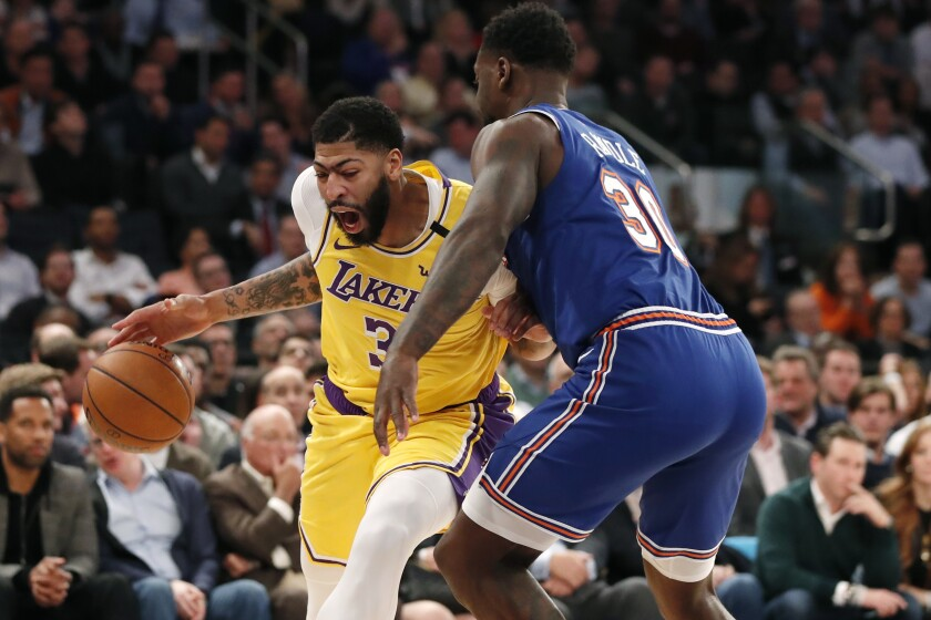 Lakers forward Anthony Davis drives against Knicks forward Julius Randle during the first half of a game Jan. 22, 2020, in New York.