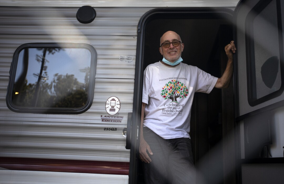 Terrance Whitten  stands in the entrance of his RV on May 13.
