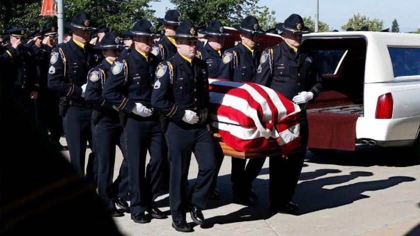 The flag draped casket of Sacramento Police Officer Tara O'Sullivan is carried into the Bayside Adventure Church for memorial services in Roseville, Calif., Thursday, June 27, 2019. O'Sullivan was shot and killed last week responding to a domestic violence call. (AP Photo/Rich Pedroncelli)