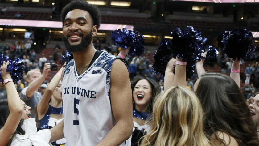 UC Irvine forward Jonathan Galloway (5) dances with cheerleaders after his team defeated Cal State F