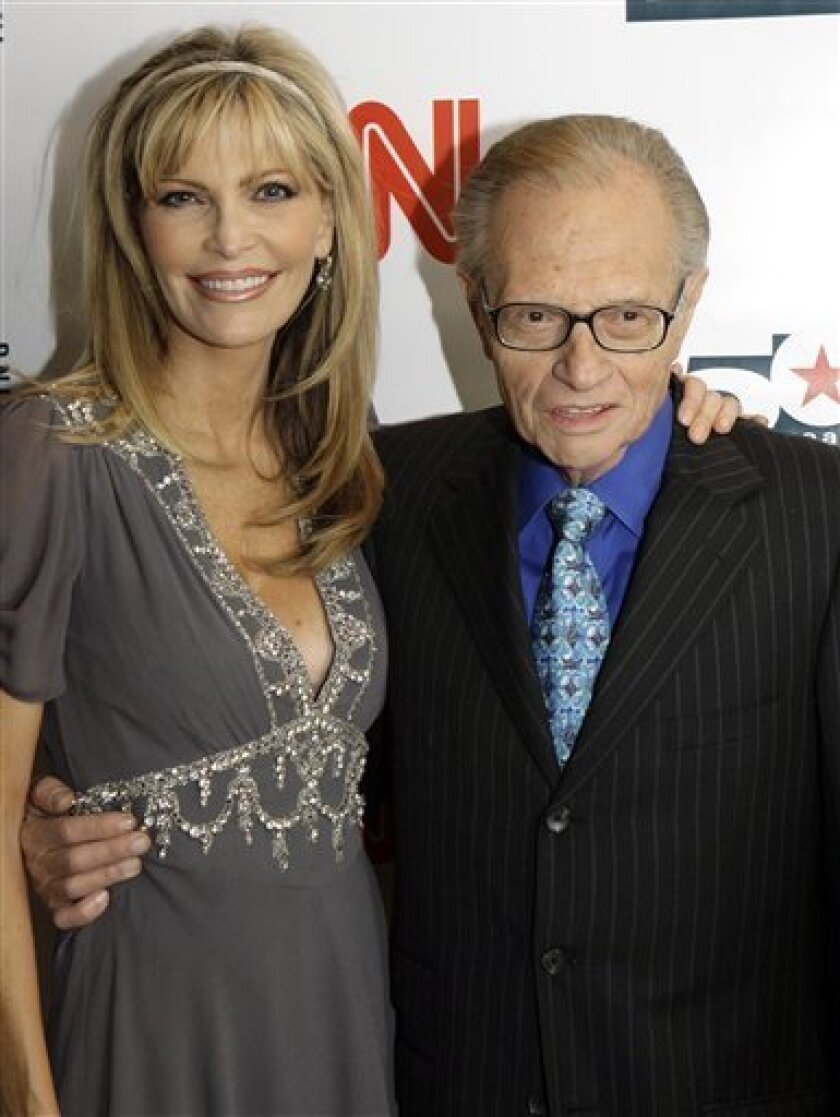 FILE - In this April 18, 2007 file photo, Larry King and his wife Shawn arrive to a party held by CNN celebrating King's fifty years of broadcasting, New York. ( AP Photo/Stuart Ramson, file)