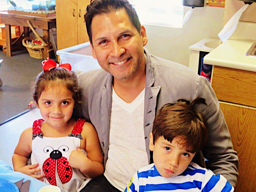 Renzzo Reyes is shown with his twins, Bailey and Bryce.