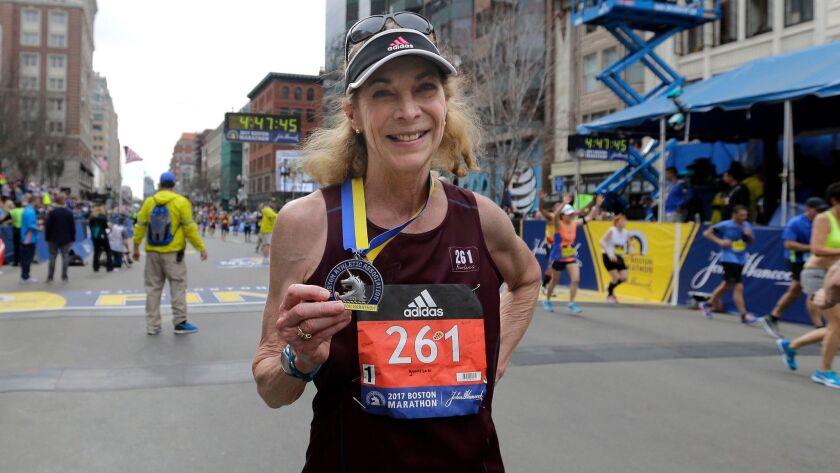 Kathrine Switzer, 70, displays her medal after finishing the 121st Boston Marathon on April 17.