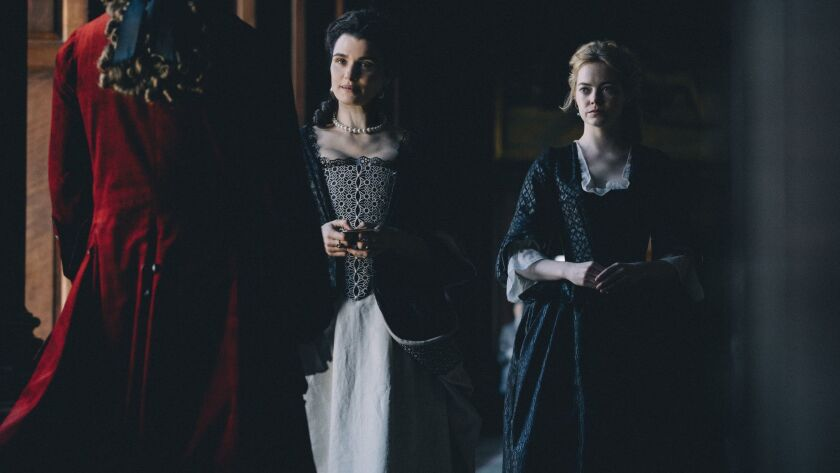 "Rachel Weisz, left, and Emma Stone in ""The Favourite."""