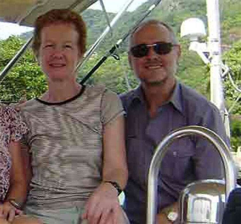 In this undated photo made available by the family, Paul and Rachel Chandler, who went missing when sailing from the Seychelles to Tanzania after sending a distress signal on Friday, Oct. 23, 2009, are seen at an unknown location. The British navy on Thursday found an empty yacht in international waters belonging to the missing British couple and a defense official said Somali pirates may have transferred them to another vessel. International naval forces have been searching for the couple for days. Paul and Rachel Chandler were heading to Tanzania in their yacht, the Lynn Rival, when a distress signal was sent last Friday. (AP Photo) EDITORIAL USE ONLY