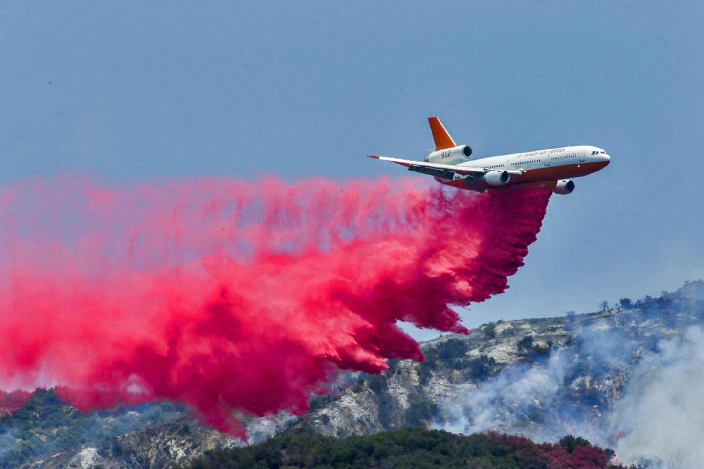 A DC-10 air tanker drops Phos-Chek, a fire retardant, on the Fish fire in Duarte on June 22.