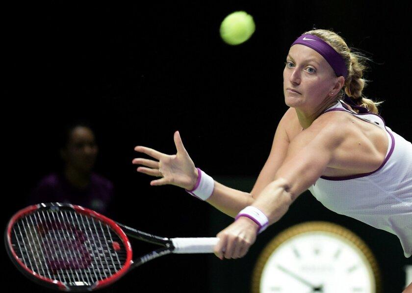 Petra Kvitova of the Czech Republic eyes the ball as she makes a return against Agnieszka Radwanska of Poland during the singles final at the WTA tennis finals in Singapore on Sunday, Nov. 1, 2015.  (AP Photo/Joseph Nair)