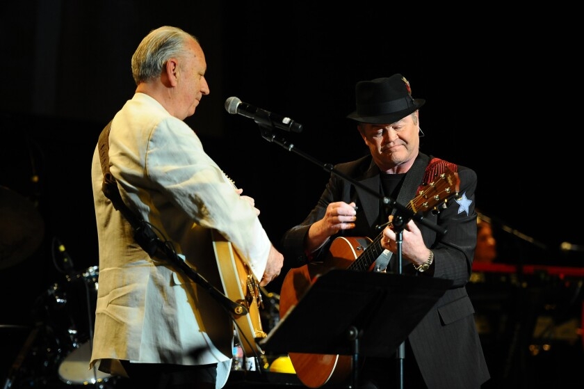 The Monkees' Michael Nesmith, left, and Micky Dolenz, will embark on the group's farewell tour in September.