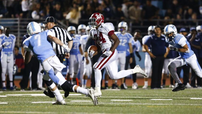 Monte Vista running back Jahmon McClendon scores on a rush in the third quarter against University City.