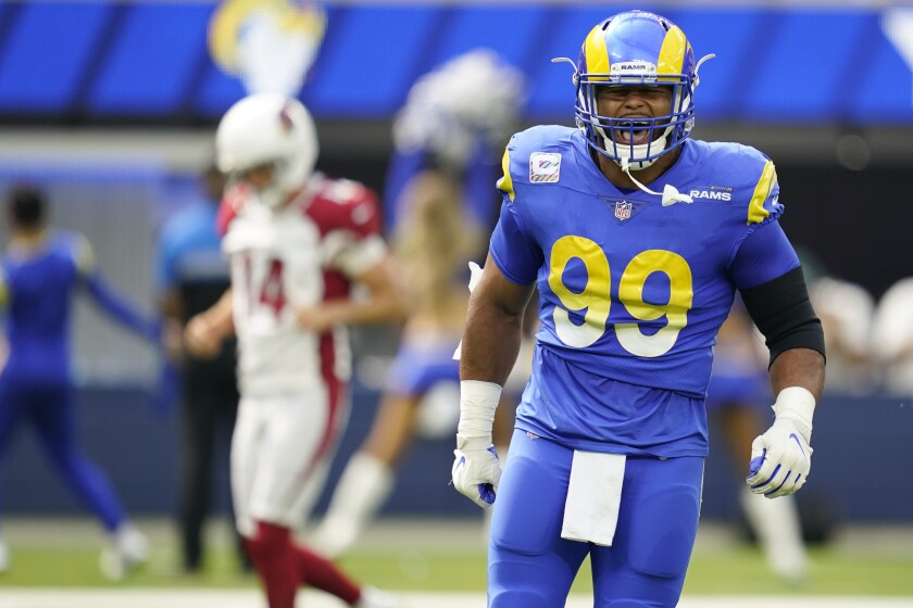 Los Angeles Rams defensive end Aaron Donald reacts after a defensive stop during the first half in an NFL football game against the Arizona Cardinals Sunday, Oct. 3, 2021, in Inglewood, Calif. (AP Photo/Ashley Landis)