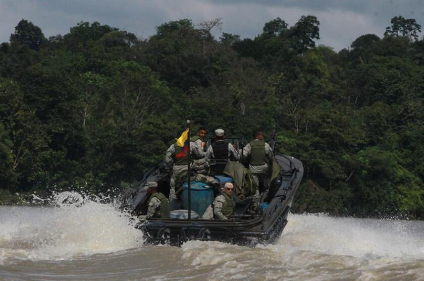 A Colombian navy unit on Nov. 7, 2018, patrols the river near Lopez de Micay, an area where drug traffickers are the lords and masters since growing coca leaf, the raw material of cocaine, continues to attract many farm hands, who either find no alternative for making a living or at least none so profitable. EFE-EPA/Ernesto Guzman Jr.
