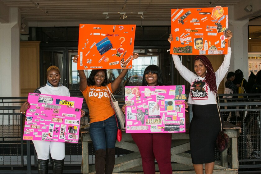(l-r) Festival attendees Coleen Burke, Diamond Joseph, Jessica Hemm, and Kendra David proudly hold up their vision boards at the ENVSN Festival at Industry City in Brooklyn on October 20, 2018.