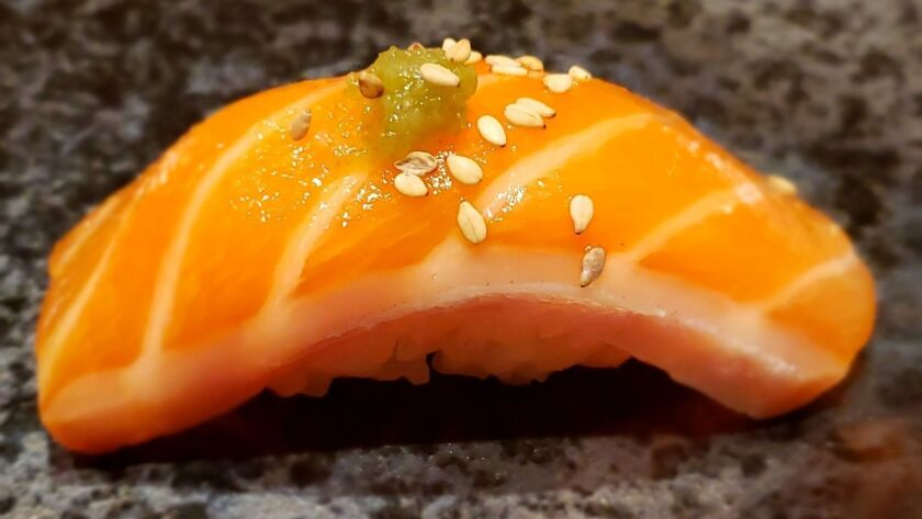 Salmon belly with yuzu pepper paste and sesame seeds, one of the nigiri courses served at Hidden Fish, an all-omakase sushi bar in Kearny Mesa.