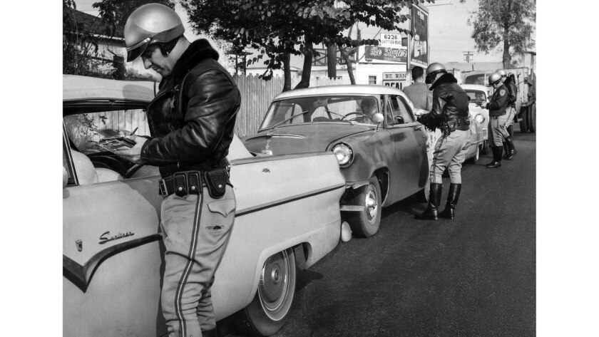 Dec. 23, 1958: C.A. Smith and other California Highway Patrol officers question motorists in East Los Angeles at a holiday traffic stop.
