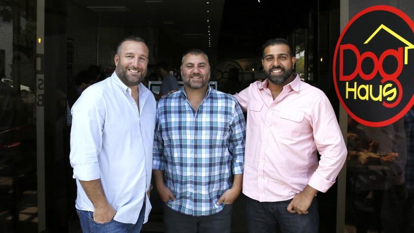 Dog Haus partners Andre Vener, from left, Hagop Giragossian and Quasim Riaz are photographed at Dog Haus in Pasadena.