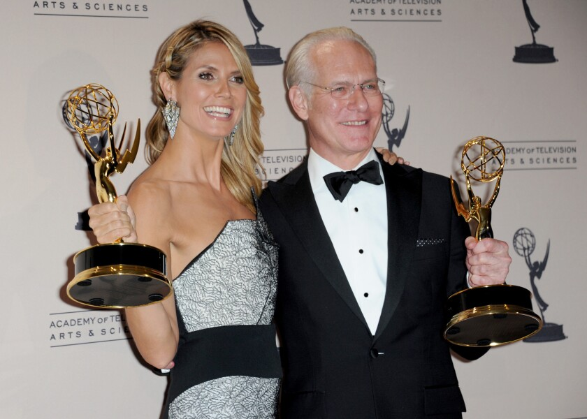 """At the Emmys in September, Heidi Klum and Tim Gunn posed backstage with their awards for outstanding host for a reality or reality-competition program for """"Project Runway."""" Gunn's TV presence will soon expand to include a new reality competition show to be seen on Lifetime."""