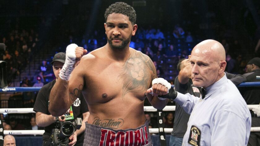 FILE - In this Nov. 4, 2017, file photo, Dominic Breazeale celebrates after defeating Eric Molina in