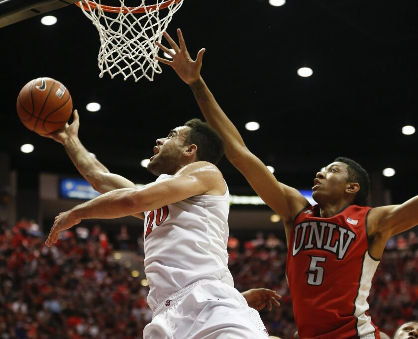 JJ O'Brien shoots as the Aztecs took on the UNLV Rebels at Viejas Arena Saturday afternoon.