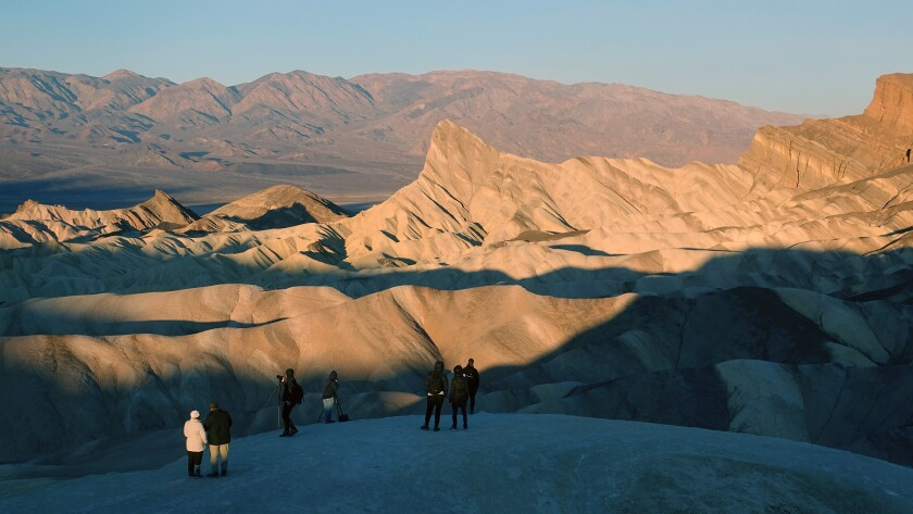 Death Valley, CA ? November 30: Visitors watch the dramatic sunrise at Zabriskie Point, when the ris