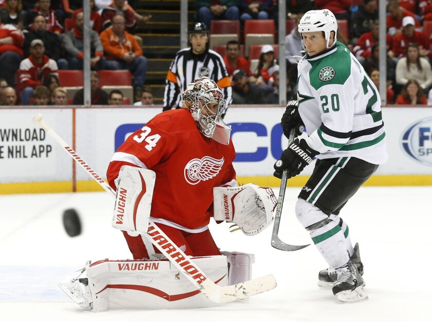 Detroit Red Wings goalie Petr Mrazek (34) defends Dallas Stars center Cody Eakin (20) in the third period of an NHL hockey game, Sunday, Nov. 8, 2015 in Detroit. (AP Photo/Paul Sancya)