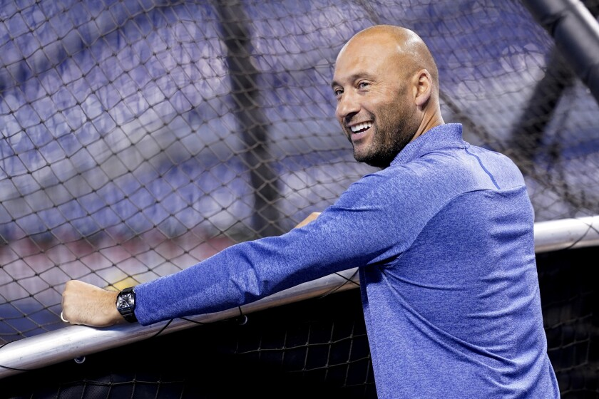 Derek Jeter, CEO of the Miami Marlins, watches batting practice before a baseball game against the Philadelphia Phillies, Saturday, Oct. 2, 2021, in Miami. (AP Photo/Lynne Sladky)