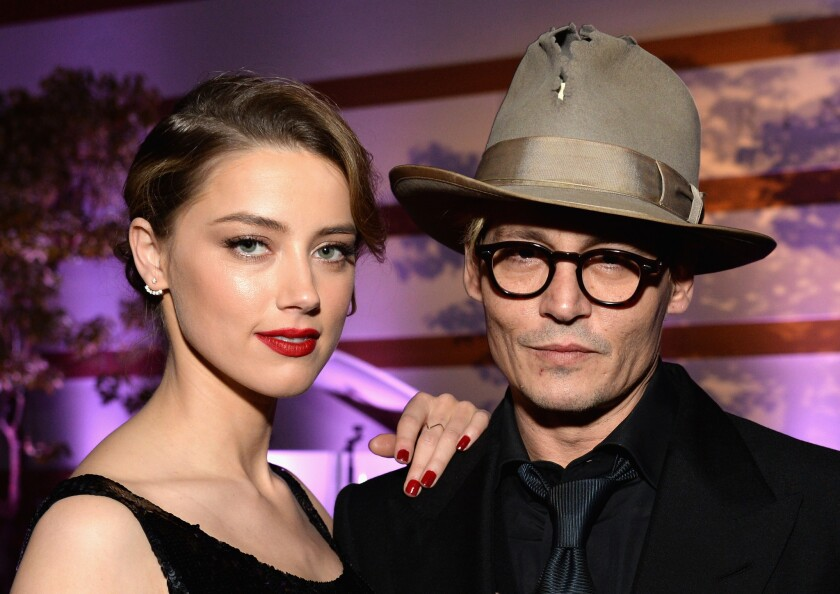 FILE: Amber Heard Reportedly Files For Divorce From Johnny Depp
