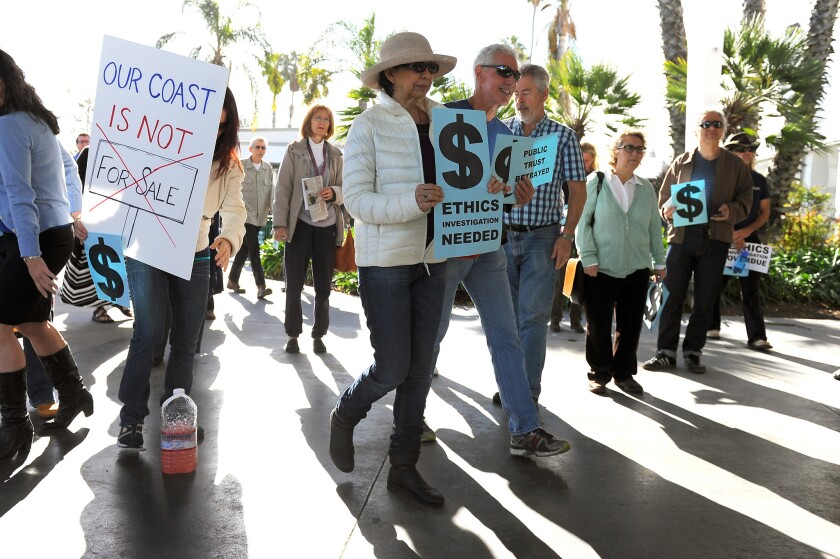 Activists rally outside the Santa Monica Civic Auditorium last month before the California Coastal Commission held its first meeting since the firing of Executive Director Charles Lester.