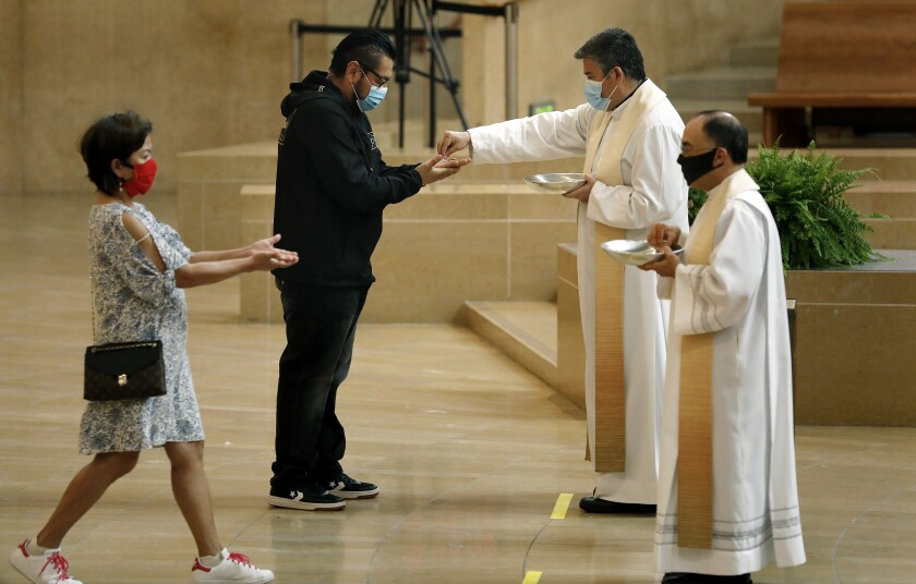 Worshipers are welcomed back at the Cathedral of Our Lady of the Angels in downtown Los Angeles on Sunday, June 7, 2020