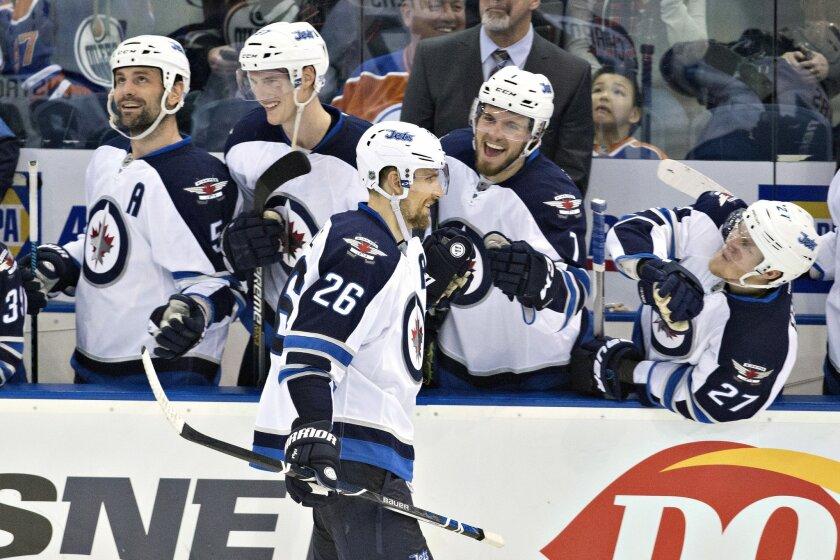 Winnipeg Jets' Blake Wheeler (26) celebrates a shootout goal against the Edmonton Oilers during an NHL hockey game Saturday, Feb. 13, 2016, in Edmonton, Alberta. Winnipeg won 2-1. (Jason Franson/The Canadian Press via AP)
