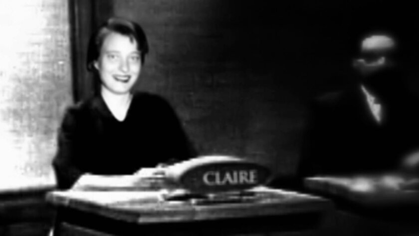 """A photograph of Claire Boiko on the set of """"Jeopardy"""" in the 1960s."""