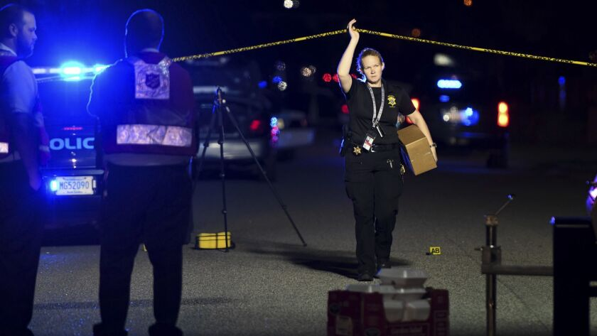 A member of the Florence County Sheriff's Office leaves the crime scene in Florence, S.C. where seven law enforcement officers were shot, one fatally, on Oct. 3.