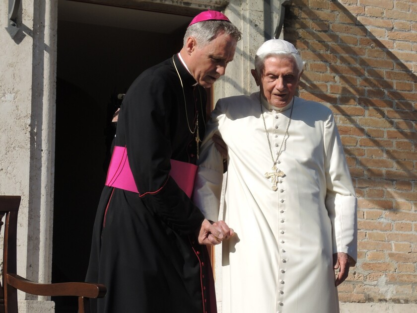 Pope Emeritus Benedict XVI, right, with personal secretary Georg Gaenswein in 2017. Benedict's involvement with a book on celibacy has been perceived as an attack on Pope Francis.