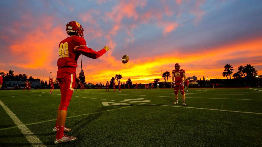 Cathedral Catholic players warm up Friday before the final game of the regular season. Playoff pairings for the San Diego Section will be announced Saturday.