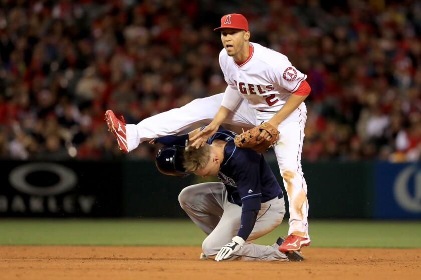 Angels shortstop Andrelton Simmons (2) leaps over sliding Rays outfielder Brandon Guyer after turning a double play during the fifth inning.