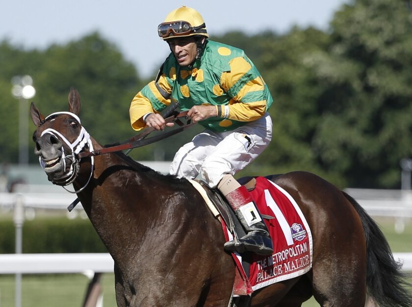 Palace Malice with John Velazquez up walks back down the track to the winners circle after winning the 121st running of the Metropolitan horse race at Belmont Park, Saturday, June 7, 2014, in Elmont, N.Y. (AP Photo/Kathy Willens)