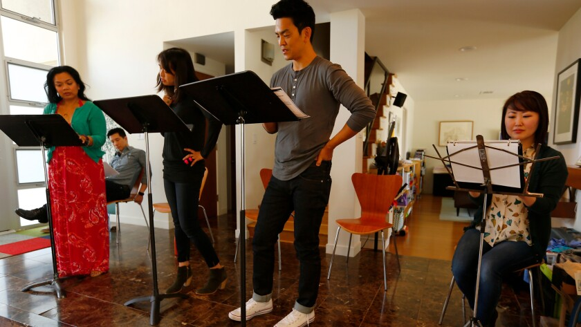 "Melody Butiu, left, Reggie Lee (sitting), Kerri Higuchi, John Cho and Julia Cho rehearse Donald Margulies' ""Dinner With Friends"" on Thursday in advance of Artists at Play's staged reading this weekend."