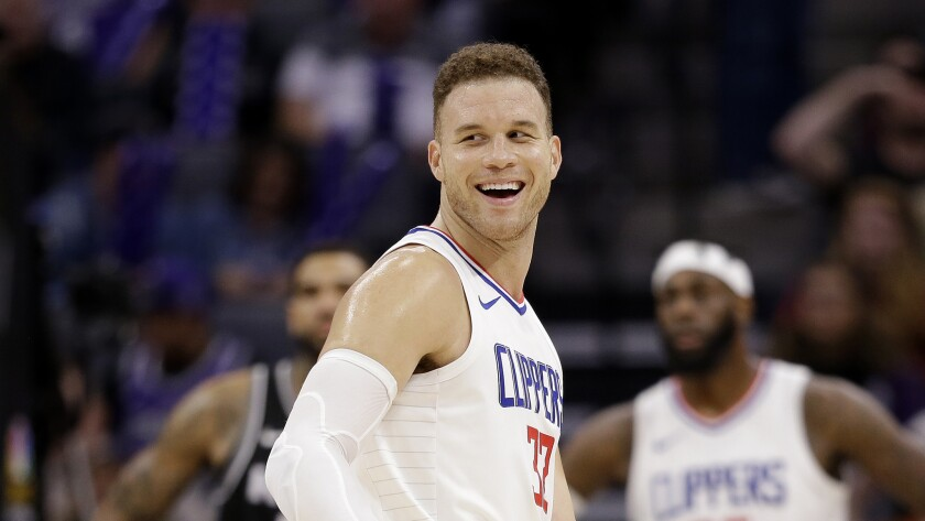 FILE - In this Jan. 11, 2018, file photo, Los Angeles Clippers forward Blake Griffin smiles during the second half of an NBA basketball game against the Sacramento Kings in Sacramento, Calif. The Detroit Pistons dramatically shook their struggling roster by acquiring one of the NBA's top players in Griffin in a trade with the Clippers. The deal for the five-time All-Star forward was announced early Tuesday, Jan. 30, 2018, giving Detroit a player who has been the face of the Clippers but whose career has been undercut by injuries.