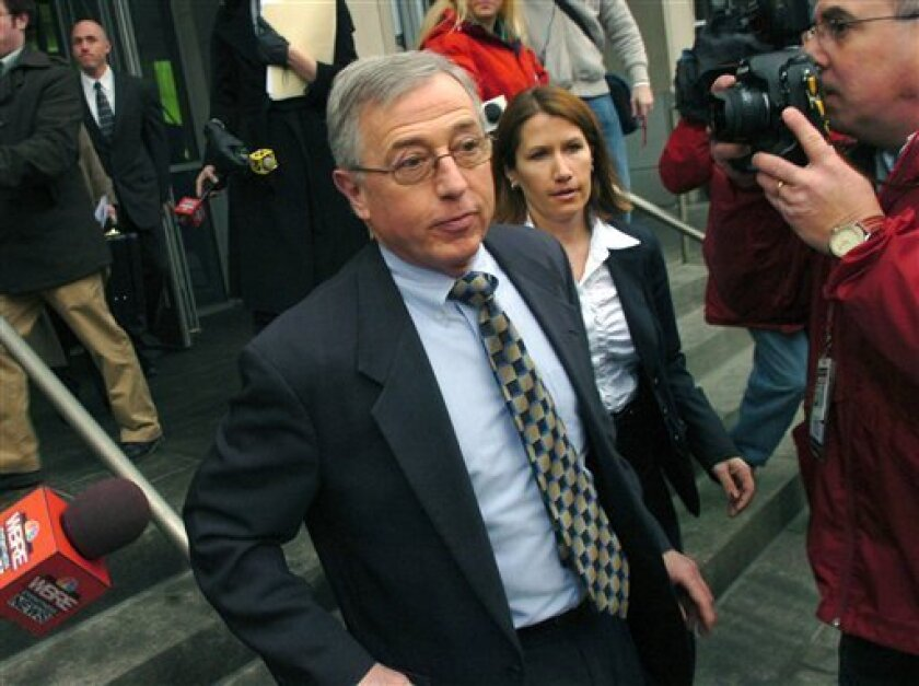 FILE -  In this Feb. 12, 2009 file photo, former Luzerne County judge Mark Ciavarella, center, leaves the federal courthouse in Scranton, Pa.  On Monday, Feb. 7, 2011, the disgraced former judge will stand trial in one of the biggest courtroom scandals in U.S. history,  a $2.8 million bribery schem