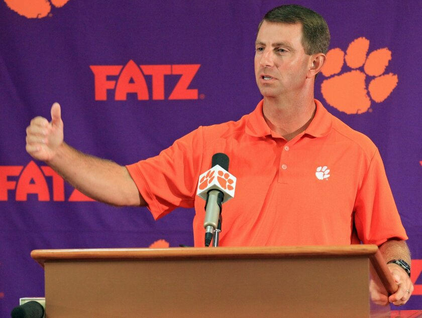 Clemson head coach Dabo Swinney discusses the Tigers' NCAA college football 2014 season at Memorial Stadium in Clemson, S.C. on Tuesday, Aug. 26, 2014. Clemson opens the season at Georgia on Aug. 30. (AP Photo/Anderson Independent-Mail, Mark Crammer) GREENVILLE NEWS OUT, SENECA NEWS OUT