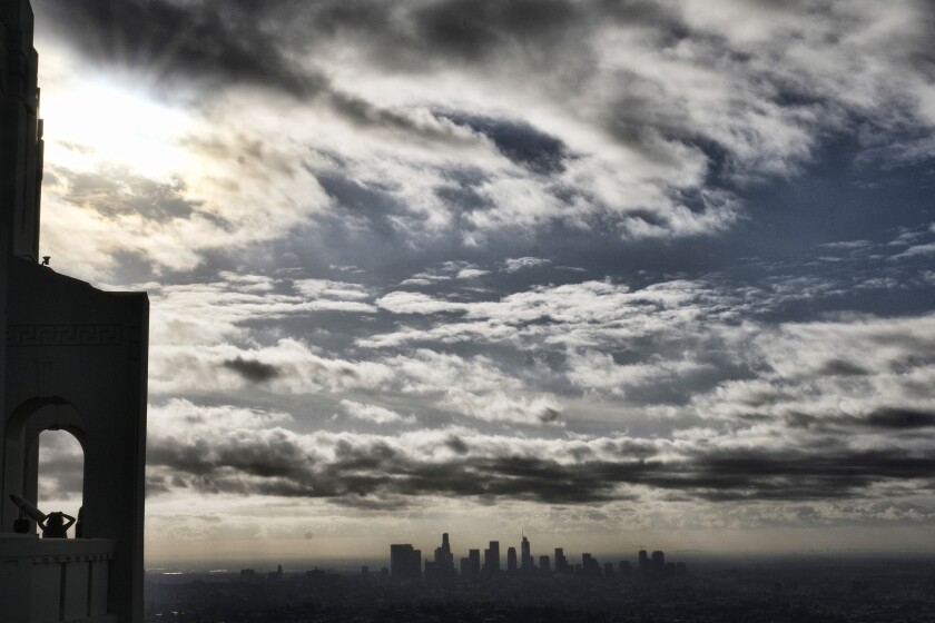 A photo taken from Griffith Observatory shows storm clouds moving over downtown Los Angeles on Wednesday.
