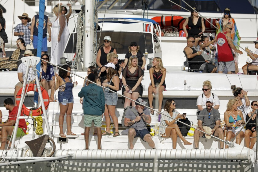 At the marina in Cabo San Lucas, Mexico, a group of visitors returns to the docks after a day on the water. The Grand Princess cruise ship passed through the same port in February.