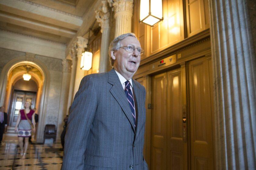 US Senate Majority Leader, Republican Mitch McConnell, walks to a meeting of Republican Senators near the Senate chamber, on Capitol Hill in Washington DC/