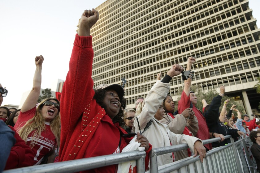 Members of United Teachers Los Angeles chant slogans as they join thousands of fellow teachers for a rally in downtown L.A. in February to demand higher wages and smaller class sizes amid stalled contract negotiations.