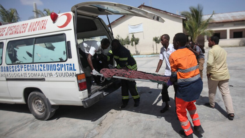 A victim is placed in an ambulance after twin explosions in Mogadishu, Somalia.